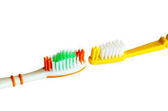 Closeup Isolated Detail of Two Colored Toothbrushes Stock Images