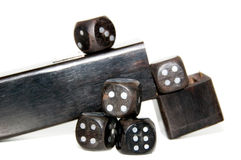 A closeup isolated photo of dice. A closeup photo of wooden dice with box isolated with shadow on a white background Stock Photography