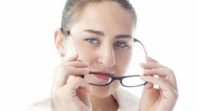 Closeup isolated portrait of sexy young woman in white shirt wearing eyeglasses. Closeup isolated portrait of sexy woman in white shirt wearing eyeglasses Royalty Free Stock Photography