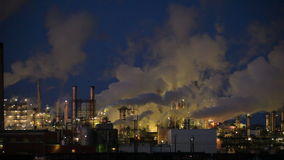 Closeup of isolated power plant at night stock footage