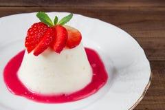 Closeup italian dessert Pannacotta with strawberries Royalty Free Stock Images