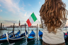 Closeup on Italian flag in hands of woman traveler in Venice Royalty Free Stock Images