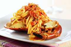 Italian pasta vermicelli with crab in tomato sauce Royalty Free Stock Photography