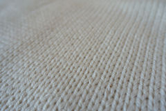 Closeup of ivory handmade stockinette stitch knitwork. Close up of ivory handmade stockinette stitch knitwork Stock Photos