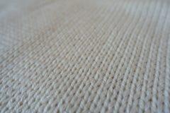 Closeup of ivory handmade stockinette stitch knitwork. Close up of ivory handmade stockinette stitch knitwork Stock Photos