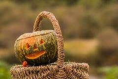 Jack-O-Lantern in wicker basket Stock Photography