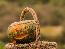 Jack-O-Lantern in wicker basket Royalty Free Stock Images