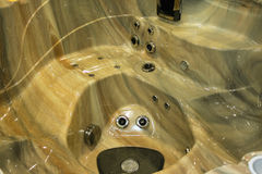 Closeup of a jacuzzi in public room of luxury health spa stock photography