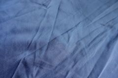 Closeup of jammed simple blue cotton fabric Royalty Free Stock Photos