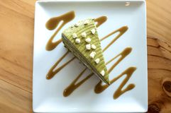 Closeup  Japanese matcha green tea cake on a white plate on table Stock Photos