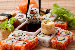 Closeup japanese sushi on a bamboo napkin. Stock Photos