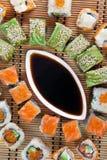 Closeup japanese sushi on a bamboo napkin. Sushi. Closeup japanese sushi on a bamboo napkin. Sushi collection Stock Photos