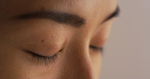Closeup of Japanese woman closing her eyes Stock Images