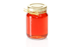 Jar of apple jelly. Closeup of jar of apple jelly on white background Stock Photos
