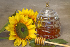 Closeup Jar of Honey amd Sunflowers Stock Photography