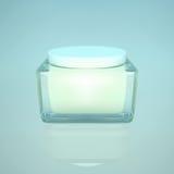 Closeup of jar of moisturizing face  beauty cream on a blue back Royalty Free Stock Image