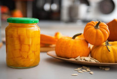 Closeup on jar of pickled pumpkin on table Stock Photos