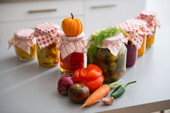 Closeup on jars of pickled vegetables on table stock photo
