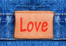 Closeup jeans leather label with text Love Royalty Free Stock Photography
