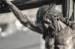 Closeup of Jesus on the cross, Holy Week in Seville, brotherhood Javieres Royalty Free Stock Image