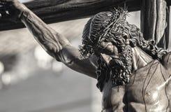 Closeup of Jesus on the cross, Holy Week in Seville, brotherhood Javieres. View of Jesus on the cross in the Holy Week in Seville Royalty Free Stock Image