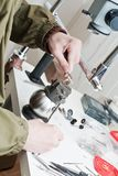 Closeup of  jeweller is working. At jeweller's workshop Royalty Free Stock Photo