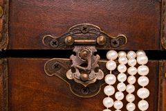 Closeup jewellery box latch and pearls Stock Image