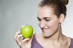 Closeup on joyful gorgeous 20s girl resisting in symbol of fresh fruit and diet Stock Photo