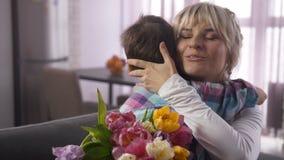 Closeup joyful mom tightly embracing beloved son