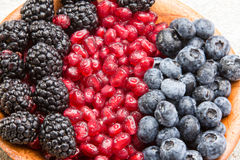 Closeup of juicy mixed berries in a wooden bowl Stock Photography