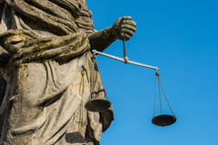 Closeup of the Justitia well in Regensburg with scales in her hands Royalty Free Stock Photo