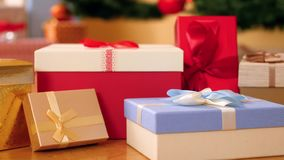Closeup 4k footage of camera panning over lots of colorful boxes with gifts and presents for Christmas or New Year stock video footage