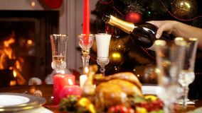 Closeup 4k footage of pouring champagne in glass on Christmas dinner