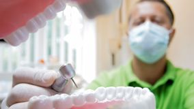 Closeup 4k footage from inside of mouth of dentist treating teeth with drill. Closeup 4k video from inside of mouth of dentist treating teeth with drill stock video footage