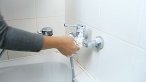 Closeup 4k footage of young woman washing water tap in bathroom with cleanser and sponge. Closeup 4k video of young woman washing water tap in bathroom with stock video footage