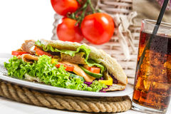 Closeup of kebab served with cold cola Stock Image