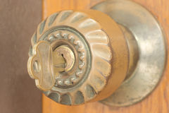 Closeup of key inside keyhole on doorknob Royalty Free Stock Images