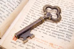 Closeup of key placed on vintage book bible. Background of Closeup of key placed on an 18st century vintage book stock photo