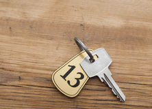 Closeup of an key of room number 13 Royalty Free Stock Images