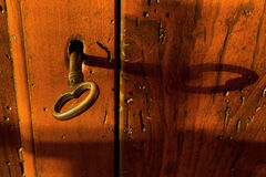 Closeup On a Key On a Wooden Chest Royalty Free Stock Photos