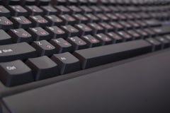 Closeup of keyboard. Closeup of black new English / Russian keyboard stock images