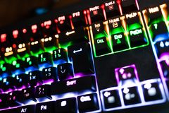 Closeup of keyboard illumination Multicolour Rainbow colors for play Games Online. Backlit keyboard Concept royalty free stock image