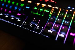 Closeup of keyboard illumination Multicolour Rainbow colors for play Games Online. backlit keyboard Concept. Closeup of keyboard illumination Multicolour Rainbow stock images