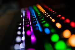 Closeup of keyboard illumination Multicolour Rainbow colors for play Games Online. Backlit keyboard Concept royalty free stock photo