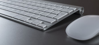 Closeup of keyboard and mouse on gray background Stock Photos