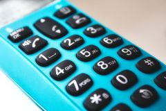 Closeup on keypad of a hand-held phone stock image