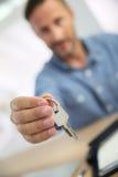 Closeup of keys given by realtor stock photos