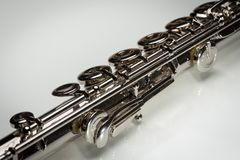 Keys of a platinum plated silver flute stock images