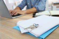 Closeup of keys set on notebook on the office desk Stock Photos