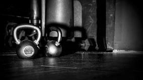Closeup 10kg Dumbbells on black background Royalty Free Stock Photos